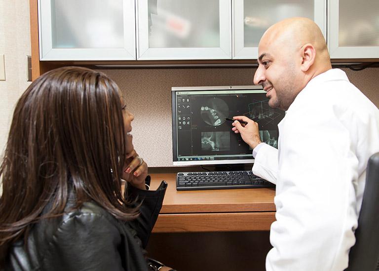 Doctor Bakuri educating a patient