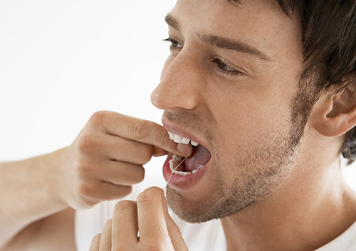 Avoid pushing the floss into this area abruptly, or snapping it into place as doing so can cut your gums as well causing bleeding and gum irritation.
